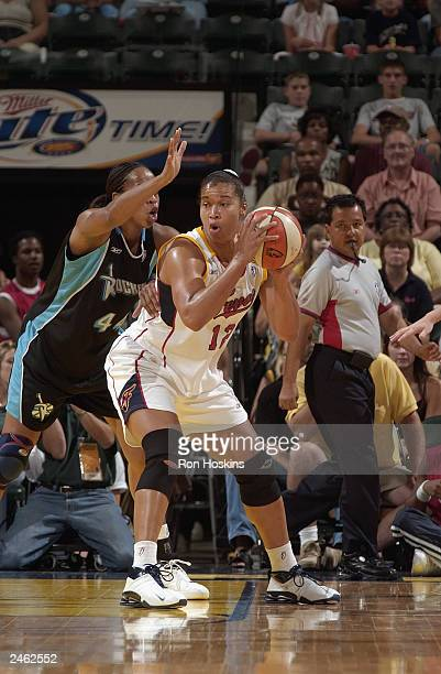Natalie Williams of the Indiana Fever is defended by Chasity Melvin of the Cleveland Rockers during the game at Conseco Fieldhouse on August 23 2003...