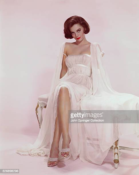 Natalie Wood actress shown seated wearing a white sexy gown Undated color slide