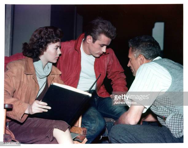 Natalie Wood and James Dean listen to director Nicholas Ray on set of the film 'Rebel Without A Cause' 1955