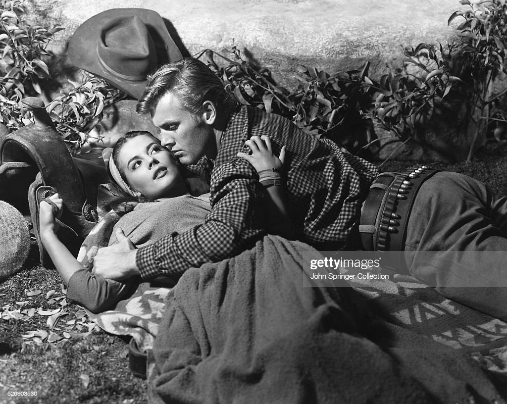 """YEAR, FOR 'THE BURNING HILLS' As Hunter recalled in the documentary """"Tab Hunter Confidential,"""" he and Wood were good friends, dancing and flirting publicly at functions together while privately carrying on their own secret romances —her with Dennis Hopper, him with Anthony Perkins."""