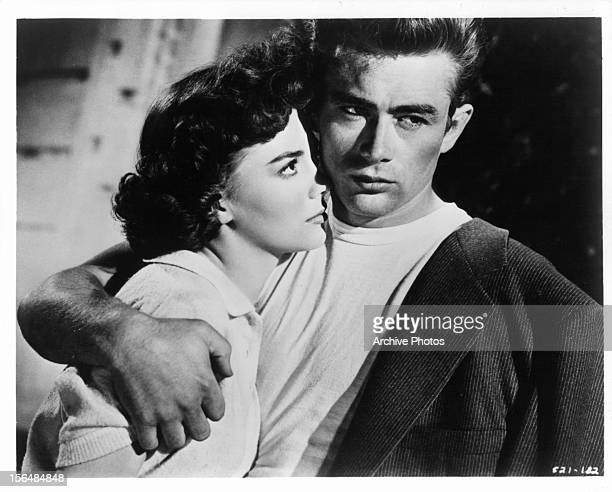 Natalie Wood is held close by James Dean in a scene from the film 'Rebel Without A Cause' 1955