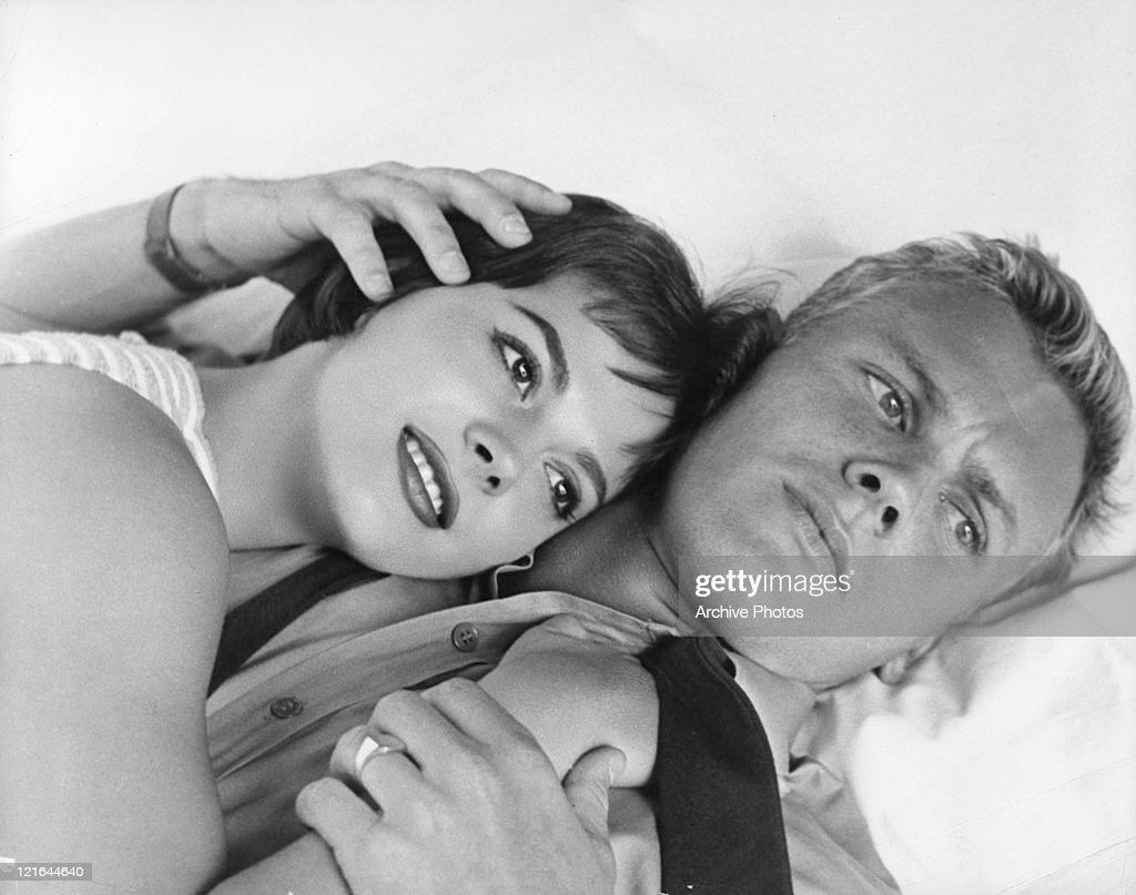 Natalie Wood lies on the chest of Tab Hunter in a scene from the film 'The Girl He Left Behind', 1956.