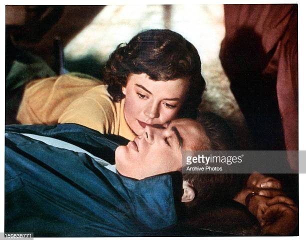 Natalie Wood lies with James Dean in a scene from the film 'Rebel Without A Cause' 1955