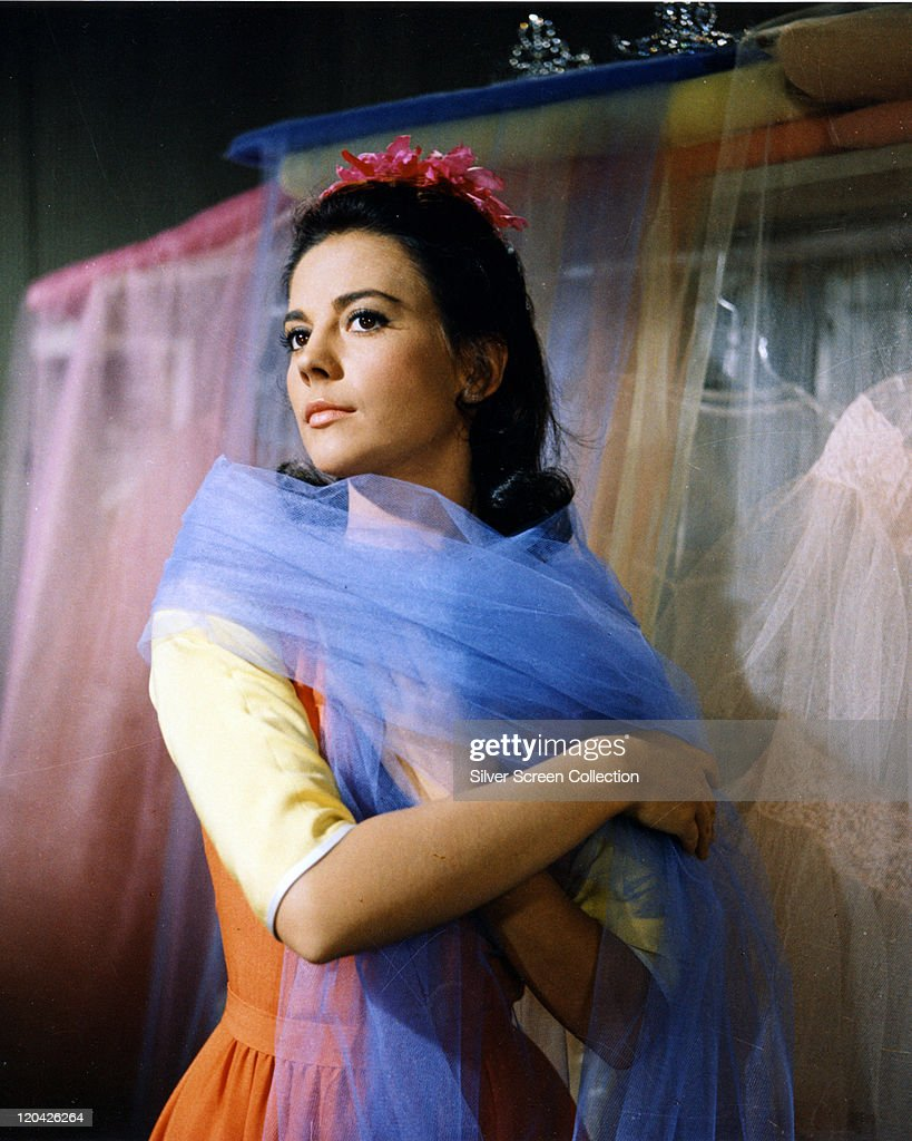 Natalie Wood (1938-1981), US actress, wearing a blue chiffon scarf in a publicity portrait issued for the film, 'West Side Story', 1961. The musical, directed by Jerome Robbins (1918-1998) and Robert Wise (1914-2005), starred Wood as 'Maria Nunez'.