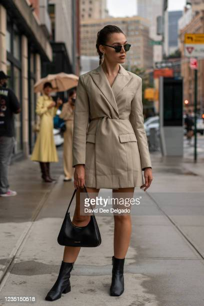 Natalie Zarra is seen wearing a dress by Usbekham, shoes by Zarra and purse by Bagllet while departing the Bevza Spring Summer 2022 fashion show at...