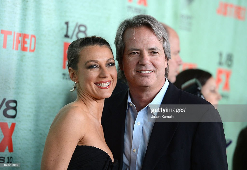 Natalie Zea and Graham Yost attend the Premiere Of FX's 'Justified' Season 4 at Paramount Theater on the Paramount Studios lot on January 5, 2013 in Hollywood, California.