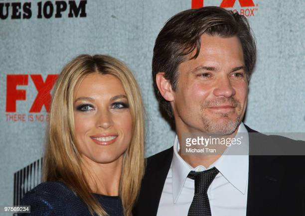 Natalie Zea and Timothy Olyphant arrive at the Los Angeles premiere screening of FX's Justified held at Directors Guild Theatre on March 8 2010 in...
