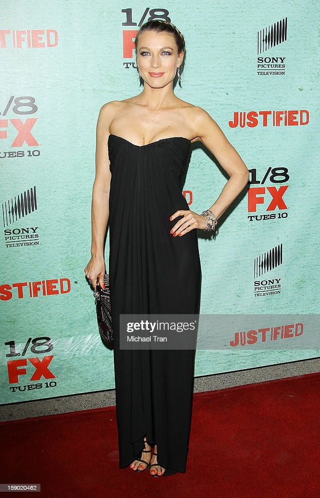 Natalie Zea arrives at season 4 premiere of FX's 'Justified' held at Paramount Theater on the Paramount Studios lot on January 5, 2013 in Hollywood, California.