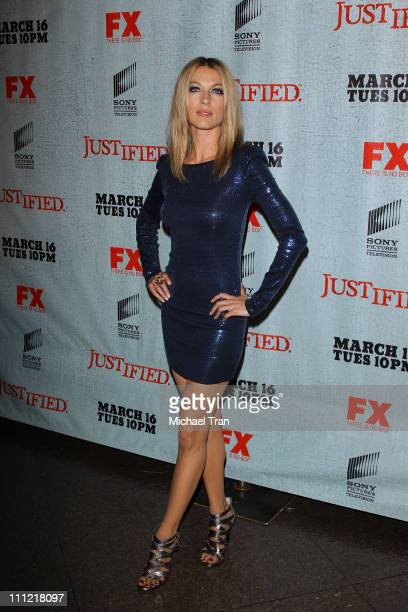 Natalie Zea arrives at the Los Angeles premiere screening of FX's 'Justified' held at Directors Guild Theatre on March 8 2010 in West Hollywood...