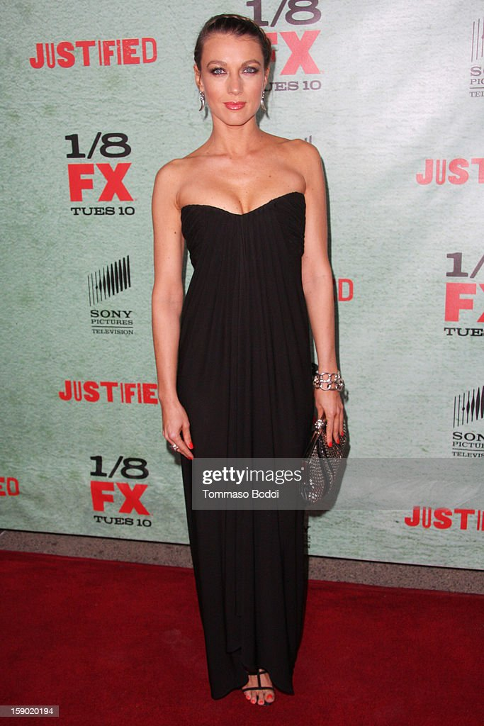 Natalie Zea attends the FX's 'Justified' season 4 premiere held at Paramount Theater on the Paramount Studios lot on January 5, 2013 in Hollywood, California.