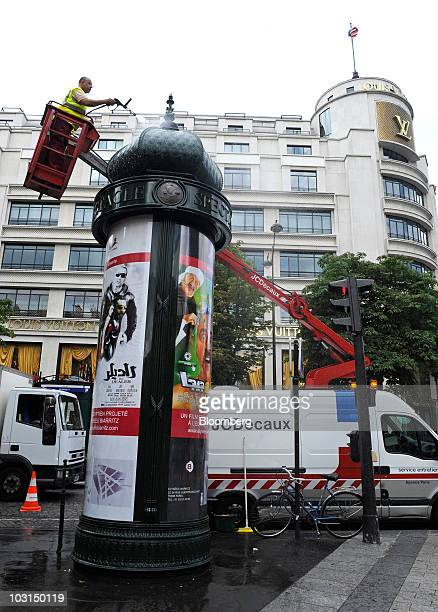 Natalino Dalio a JCDecaux SA employee cleans an advertising kiosk in Paris France on Wednesday July 28 2010 JCDecaux SA the world's secondlargest...