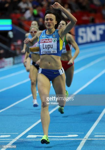 Nataliya Lupu of Ukraine crosses the line to win gold in the Men's 800m Final during day three of European Indoor Athletics at Scandinavium on March...