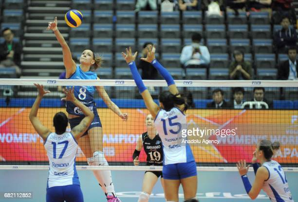 Nataliya Obmochaeva of Dinamo Moscow in action against Drussyla Felix Ana Da Silva and Roberta Ratzke during the pool match of the FIVB Womens Club...