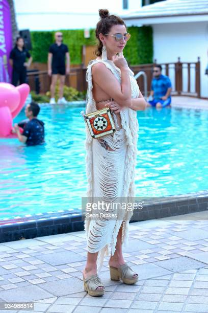 Natallia Lokun of New York wears a handwoven dress from Tulum Mexico with a bag from Morocco during the Behrouz Friends Pool Party produced by 935FM...