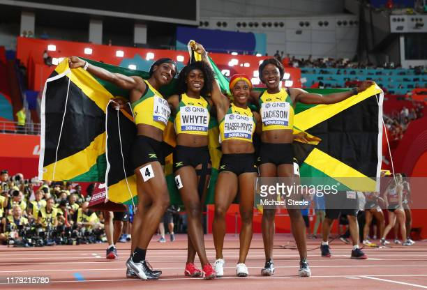 Natalliah Whyte, Shelly-Ann Fraser-Pryce, Jonielle Smith and Shericka Jackson of Jamaica celebrate gold in the Women's 4x100 Metres Relay during day...