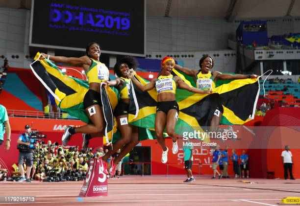 Natalliah Whyte, Shelly-Ann Fraser-Pryce, Jonielle Smith and Shericka Jackson celebrate gold in the Women's 4x100 Metres Relay during day nine of...