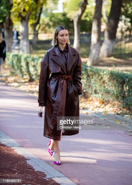 Nataly Osmann is seen wearing brown belted coat mini bag during day 4 of the MercedesBenz Tbilisi Fashion Week on November 03 2019 in Tbilisi Georgia