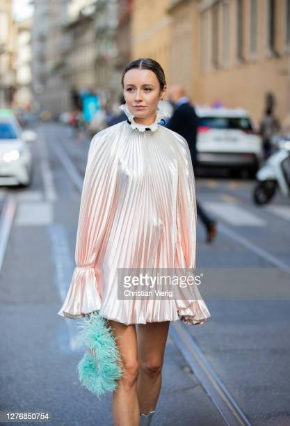 Nataly Osmann seen wearing pleated dress, clutch outside Philosophy during the Milan Women's Fashion Week on September 26, 2020 in Milan, Italy.