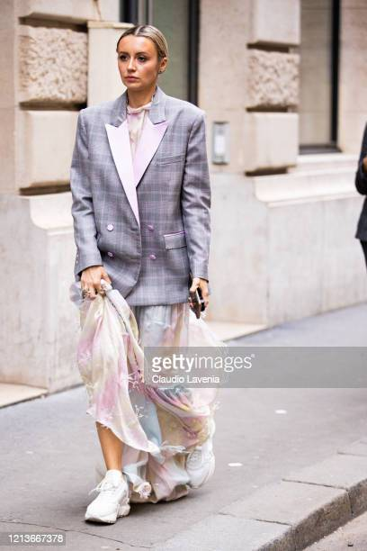 Nataly Osmann, wearing a pastel maxi dress, grey checked blazer and white sneakers, is seen outside Ralph & Russo, during Paris Fashion Week -...