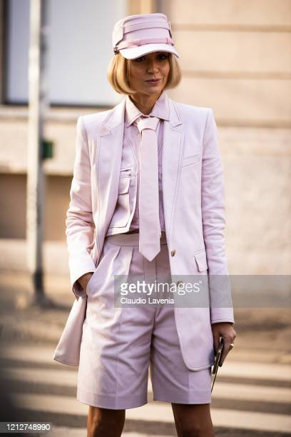 Nataly Osmann, wearing a pink shirt with matching blazer and shorts and pink hat, is seen outside Max Mara show, during Milan Fashion Week...