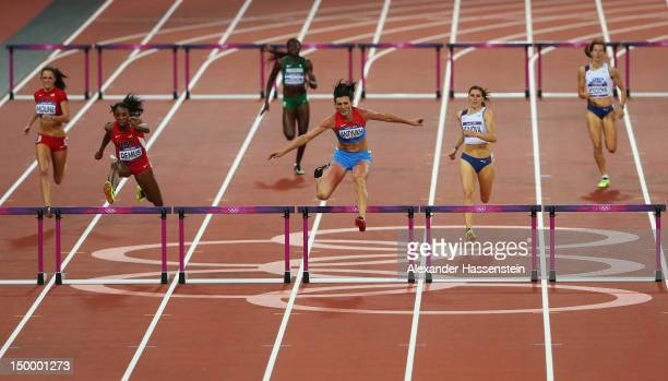 Natalya Antyukh of Russia and Lashinda Demus of the United States lead the field in the Women's 400m Hurdles Final on Day 12 of the London 2012...