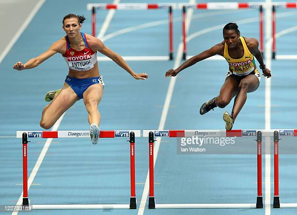 Natalya Antyukh of Russia and Melaine Walker of Jamaica compete in the women's 400 metres hurdles heats during day three of the 13th IAAF World...
