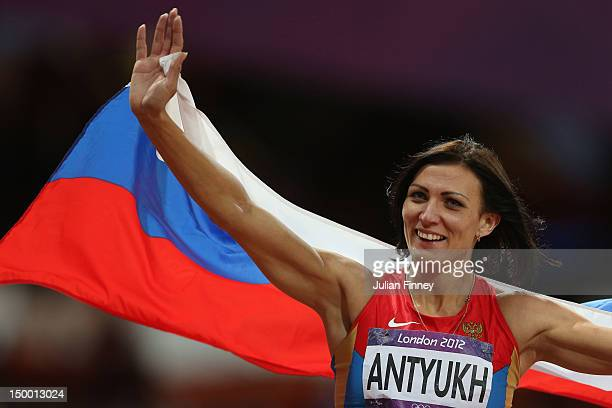 Natalya Antyukh of Russia celebrates winning gold in the Women's 400m Hurdles Final on Day 12 of the London 2012 Olympic Games at Olympic Stadium on...