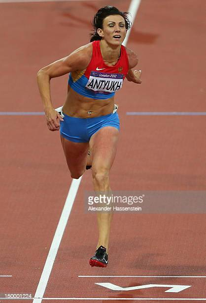Natalya Antyukh of Russia cross the finish line to win gold in the Women's 400m Hurdles Final on Day 12 of the London 2012 Olympic Games at Olympic...