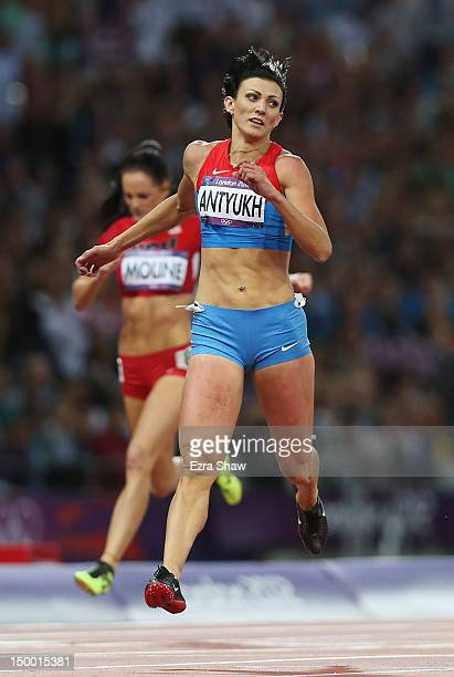 Natalya Antyukh of Russia crosses the finish line to win gold in the Women's 400m Hurdles Final on Day 12 of the London 2012 Olympic Games at Olympic...