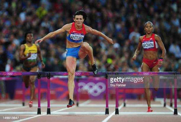 Natalya Antyukh of Russia jumps a hurdle in the Women's 400m Hurdles semifinal on Day 10 of the London 2012 Olympic Games at the Olympic Stadium on...