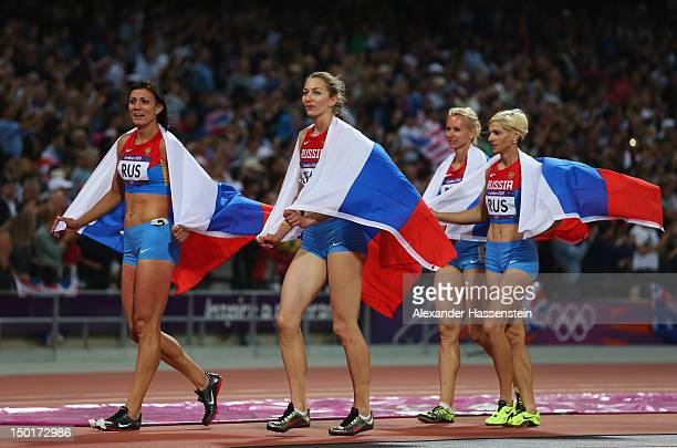 Natalya Antyukh Tatyana Firova Yulia Gushchina and Antonina Krivoshapka of Russia celebrate winning silver in the Women's 4 x 400m Relay Final on Day...