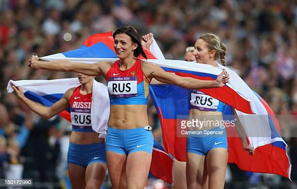 Natalya Antyukh Tatyana Firova Yulia Gushchina and Antonina Krivoshapka of Russia celebrate winning silver in the Women's 4 x 400m Relay Final on Day...
