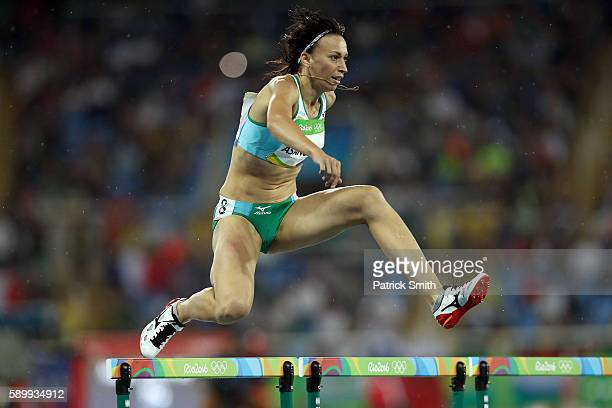Natalya Asanova of Uzbekistan competes in the round one of the Women's 400m Hurdles on Day 10 of the Rio 2016 Olympic Games at the Olympic Stadium on...