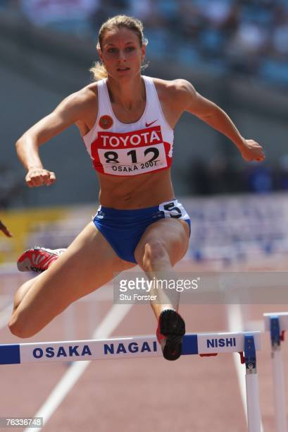 Natalya Ivanova of Russia competes during the Women's 400m Hurdles Heats on day three of the 11th IAAF World Athletics Championships on August 27...