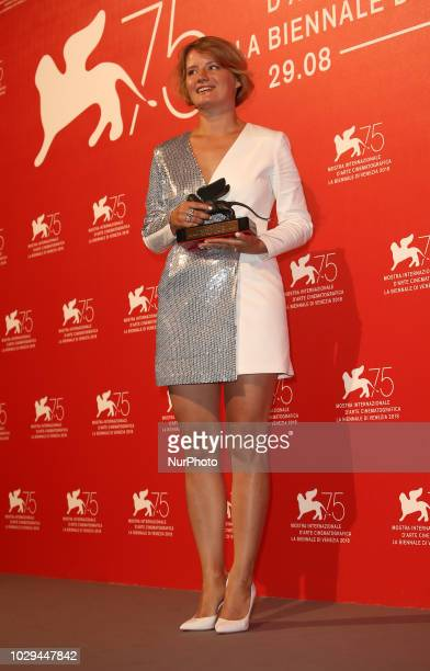 Natalya Kudryashova poses with the Orizzonti Award for Best Actress for 'The Man Who Surprised Everyone' at the Winners Photocall during the 75th...