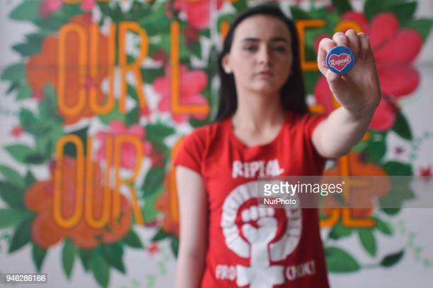 Natalya O'Flaherty a spoken word artist and an activist holds 'Repeal' badge during a Rally for Equality Freedom amp Choice organised by ROSA an...