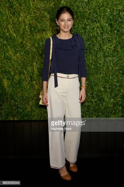 Natalya Poniatowski wears CHANEL jeans with a navy cupro and polyester pullover from the Cruise 2017/18 Collection with aCHANEL Bag at the CHANEL...