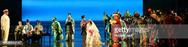 Natalya Romaniw as CioCio San and Dimitri Pittas as Pinkerton with artists of the company in the English National Opera's production of Giacomo...