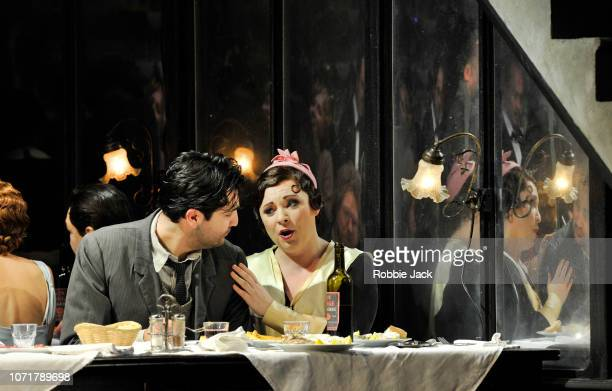 Natalya Romaniw as Mimi and Jonathan Tetelman as Rodolfo with artists of the company in English National Opera's production of Giacomo Puccini's La...