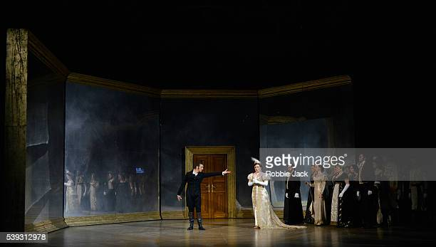 Natalya Romaniw as Tatyana and Roderick Williams as Eugene Onegin with artists of the company in Garsington Opera's production of Pyotr Ilyich...