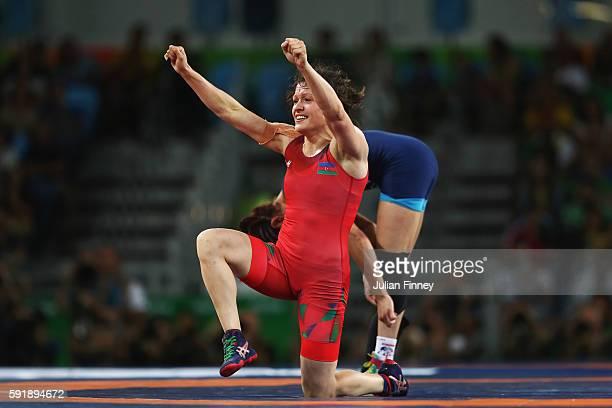 Natalya Sinishin of Azerbaijan celebrates after defeating Betzabeth Angeli Arguello Villegas of Venezuela during the Women's Freestyle 53 kg Bronze...