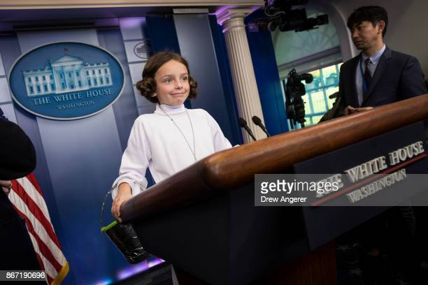 Natalynn Parkinson dressed as Star Wars character Princess Leia stands at the lectern following the daily press briefing at the White House October...