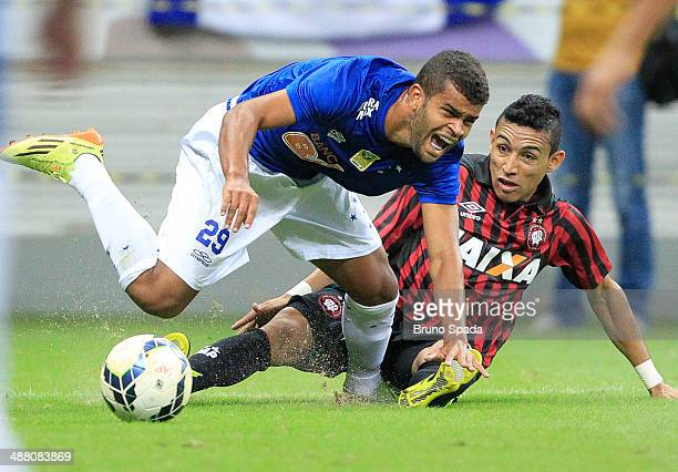 Natanael of Atletico Paranaense fights for the ball with Alisson of Cruzeiro as part of Brasileirao Series A 2014 at Mane Garrincha Stadium on May 3...