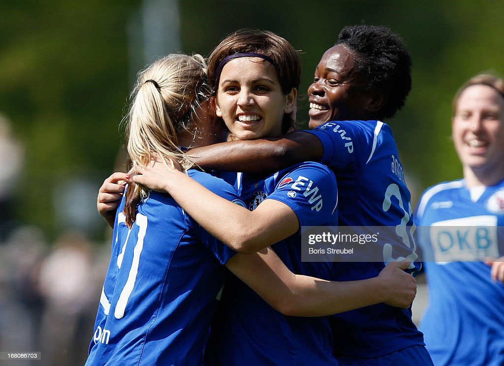 Natasa Andonova of Potsdam (C) celebrates with team-mates Pauline Bremer (L) and Genoveva Anonma after scoring their team's first goal during the Women's Bundesliga match between 1. FFC Turbine Potsdam and VfL Wolfsburg on May 5, 2013 in Potsdam, Germany.