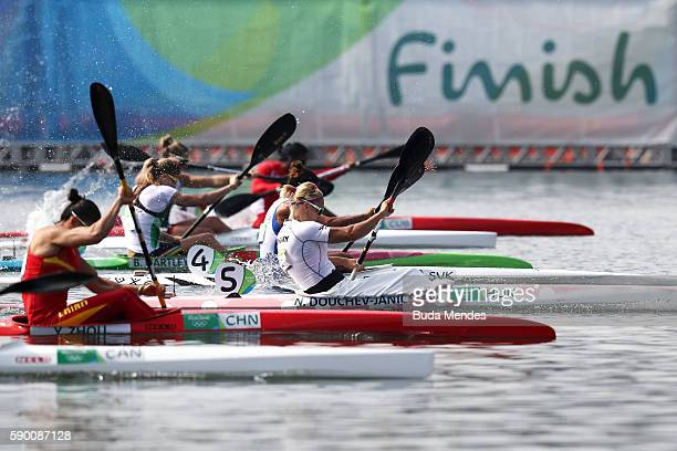 Natasa DouchevJanic of Hungary and Yu Zhou of China compete during the Women's Kayak Single 200m Final B on Day 11 of the Rio 2016 Olympic Games at...