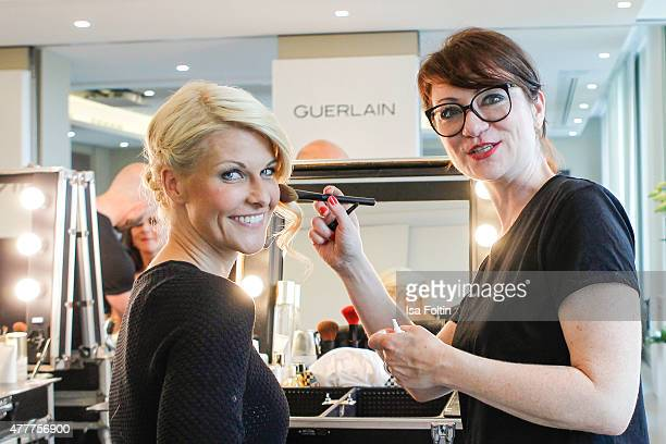 Natascha Gruen and a make up artist ahead of the German Film Award 2015 Lola on June 19 2015 in Berlin Germany