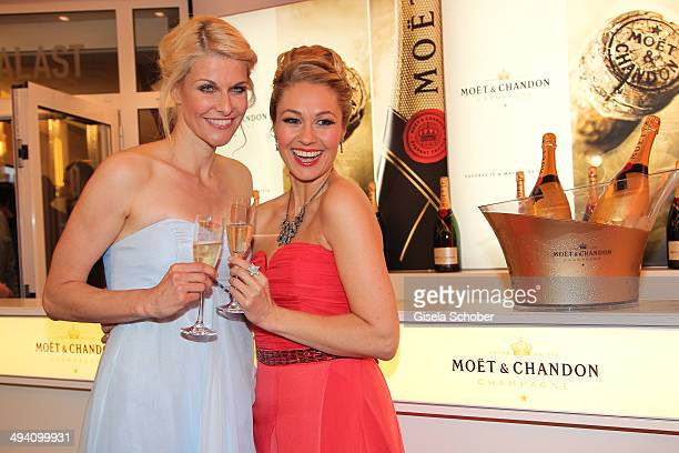 Natascha Gruen and Ruth Moschner attend the Fashion Meets Movie gala screening of Maleficent at Gloria Palast on May 27 2014 in Munich Germany