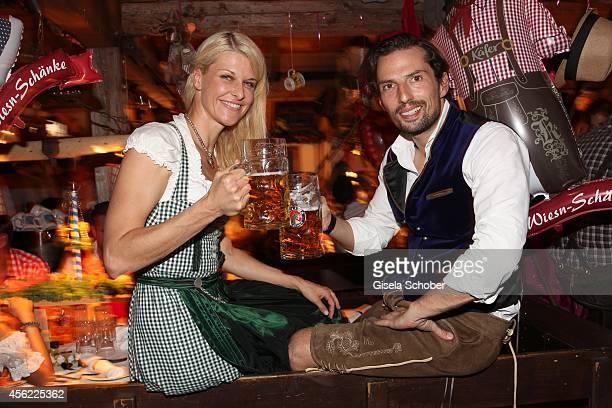 Natascha Gruen Dresscoded and Quirin Berg during Oktoberfest at Kaeferzelt/Theresienwiese on September 27 2014 in Munich Germany