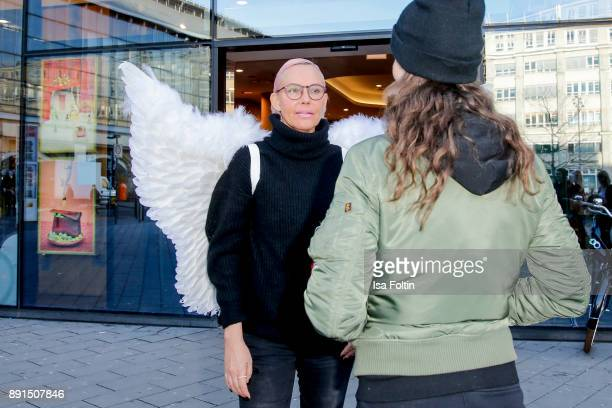 Natascha Ochsenknecht wearing angel wings and suprises a customer during a photo call at TK Maxx on December 13 2017 in Berlin Germany