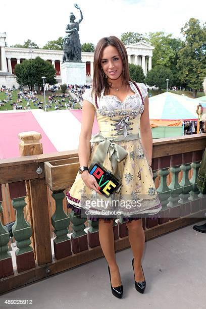 Natascha Tannous wearing a dirndl by Lola Paltinger during the Oktoberfest 2015 Opening at Kaeferschaenke beer tent at Theresienwiese on September...